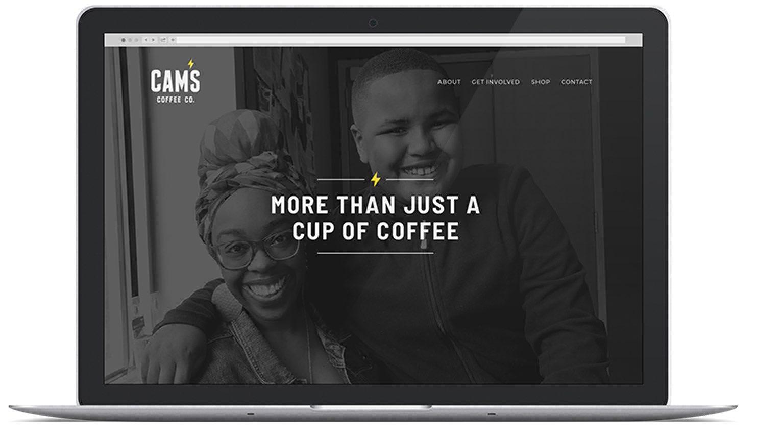 Cam's website on laptop