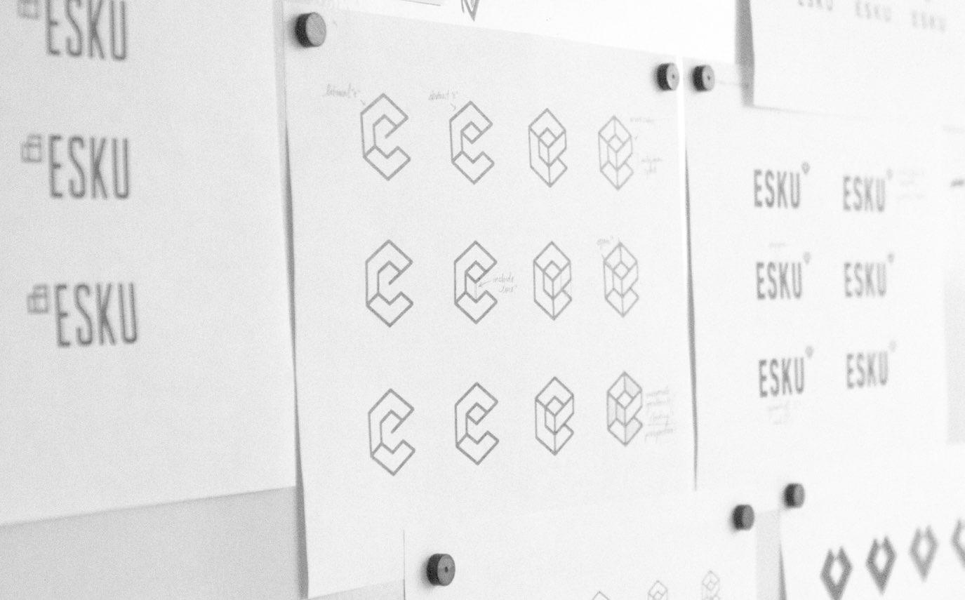 Esku logo sketches on whiteboard