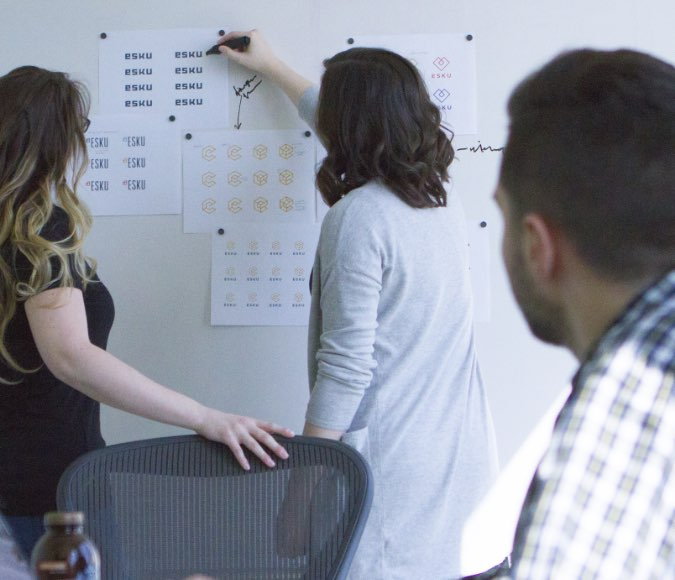 Designers at a whiteboard