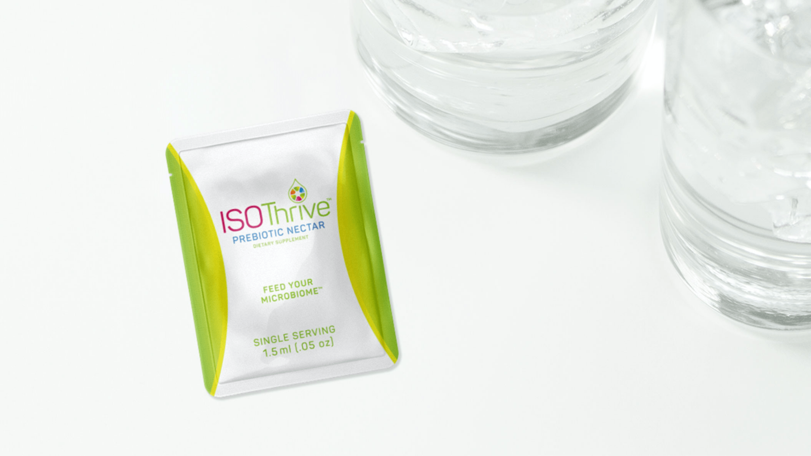 Iso Thrive packet with water glass